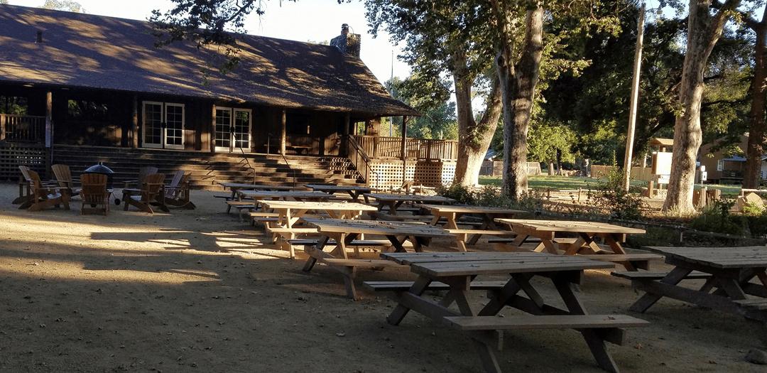picnic tables outside a lodge