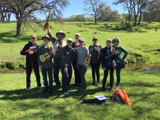 group of people playing ukulele