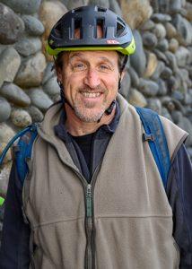 bob horowitz wearing bike helmet in front of stone rockwall