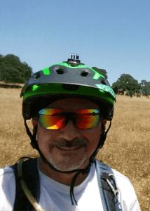 greg tenorio in bike helmet at deer creek hills meadow
