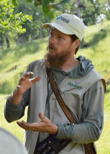 Thomas Baumann leading a class in a grassy oak woodland